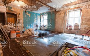 Interior of apartment with materials during on the renovation and construction ( making wall from gypsum plasterboard)